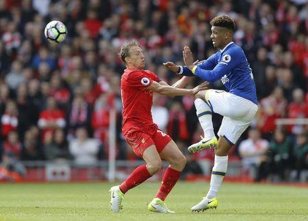 Britain Soccer Football - Liverpool v Everton - Premier League - Anfield - 1/4/17 Everton's Mason Holgate in action with Liverpool's Lucas Leiva Action Images via Reuters / Carl Recine Livepic