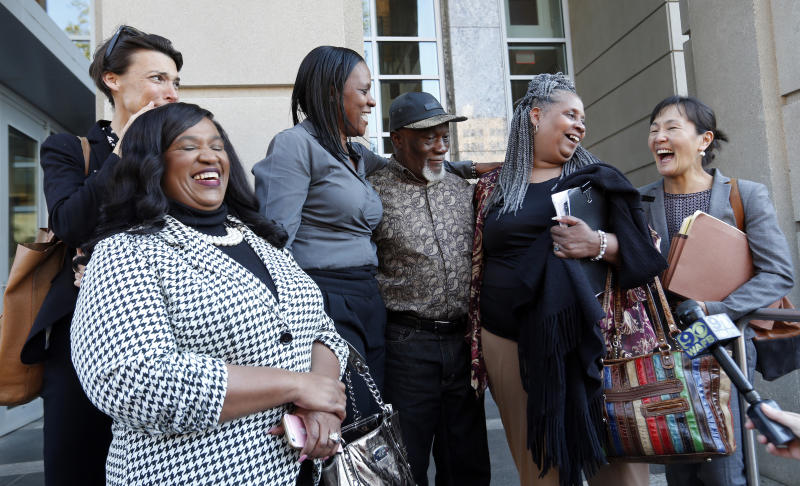 Family members of Wilbert Jones, flanked by attorneys from Innocence Project New Orleans, speak on the steps of state district court in Baton Rouge, La., Tuesday, Nov. 14, 2017. The Louisiana man who has spent nearly 50 years in prison will be freed after a judge overturned his conviction in the kidnapping and rape of a nurse. State District Court Judge Richard Anderson set Wilbert Jones' bail at $2,000 after hearing arguments from defense attorneys and prosecutors in a Baton Rouge courtroom. One of his lawyers expects him to be released Wednesday. Anderson threw out Jones' conviction on Oct. 31, saying authorities withheld evidence that could have exonerated Jones decades ago. (AP Photo/Gerald Herbert)