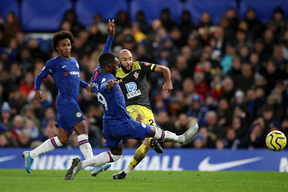 LONDON, ENGLAND - DECEMBER 26: Nathan Redmond of Southampton shoots under pressure from Fikayo Tomori of Chelsea during the Premier League match between Chelsea FC and Southampton FC at Stamford Bridge on December 26, 2019 in London, United Kingdom. (Photo by Steve Bardens/Getty Images)