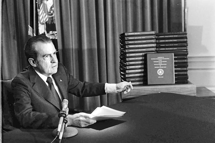 President Nixon with stacks of transcripts of the White House tapes in an April 29, 1974, address.