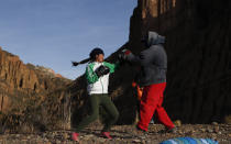 Gracce Kelly Flores, a 12-year-old boxer who goes by the nickname Hands of Stone, does her daily boxing workout as she trains with her father Alberto Flores in Palca, Bolivia, early Thursday, June 10, 2021, amid the COVID-19 pandemic. At age 8, Flores defeated a 10-year-old boy, and with three national boxing medals under her belt, she dreams of reaching the women's boxing world championship. (AP Photo/Juan Karita)