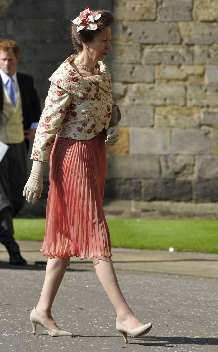 <p>Mother-of-the-bride Princess Anne arrives at the wedding of her daughter Zara with a decorative flower ornament in her hair.</p>
