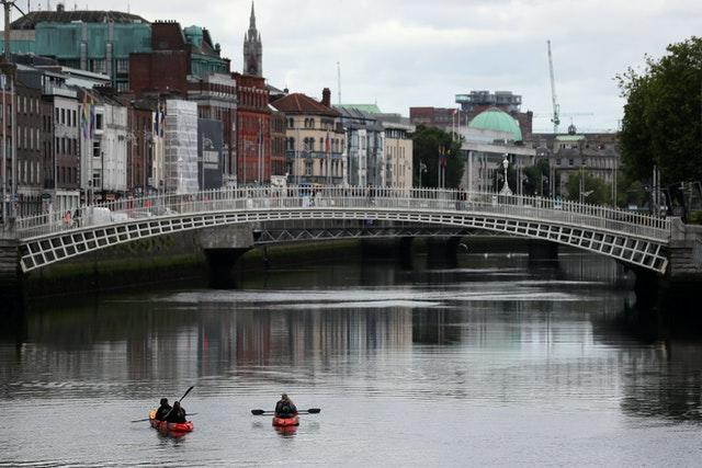 People kayak on the river Liffey in Dublin (Brian Lawless/PA)