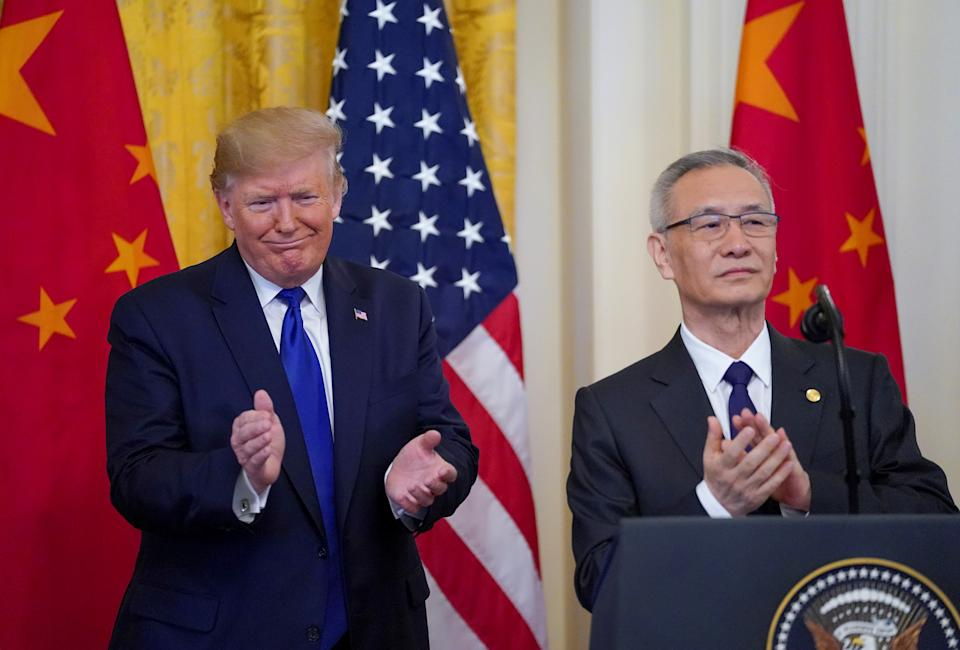 "U.S. President Donald Trump applauds with Chinese Vice Premier Liu He prior to signing ""phase one"" of the U.S.-China trade agreement with Liu in the East Room of the White House in Washington, U.S., January 15, 2020. REUTERS/Kevin Lamarque?"