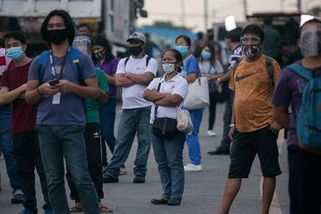 Philippines back under lockdown as virus cases continue to surge