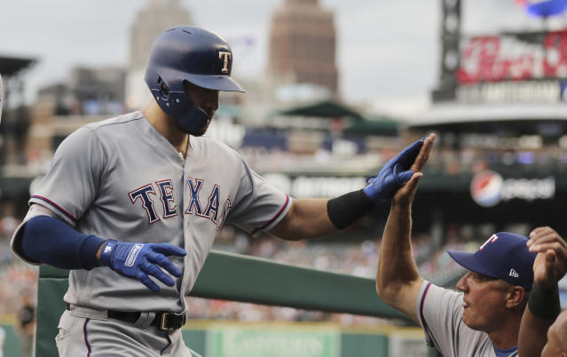 Texas Rangers' Joey Gallo is greeted in the dugout after hitting a two-run home run during the second inning against the Detroit Tiger in a baseball game Thursday, July 5, 2018, in Detroit. (AP Photo/Carlos Osorio)