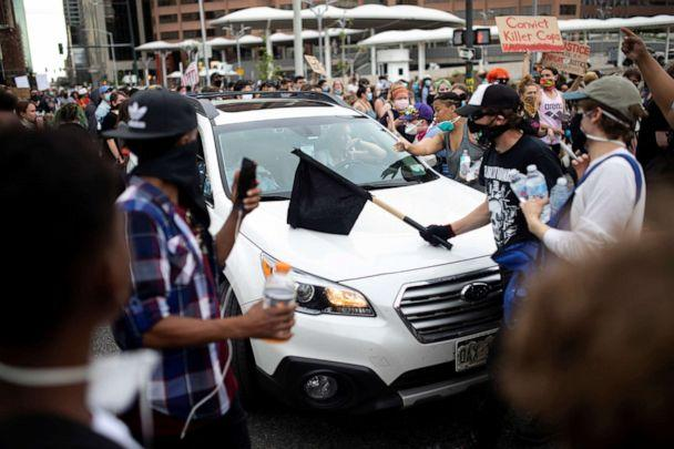 PHOTO: A driver tries to get through the streets as protesters rally against the death in Minneapolis police custody of George Floyd, in Denver, May 30, 2020. (Alyson Mcclaran/Reuters)