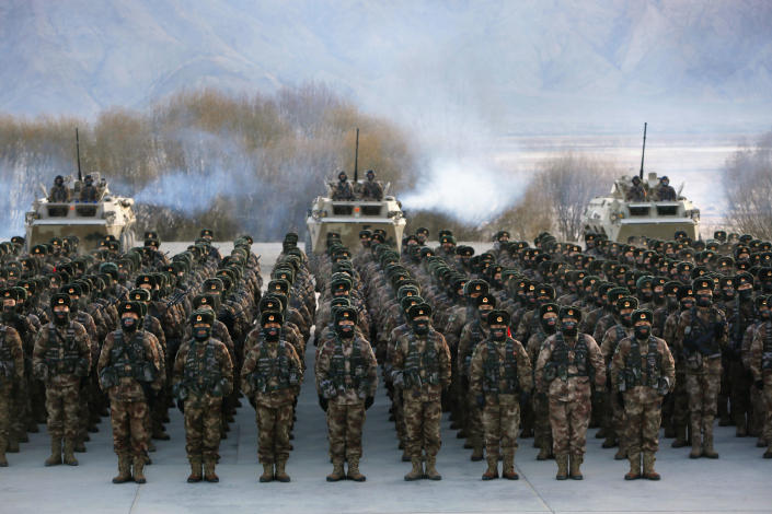 FILE - In this Jan. 4, 2021, file photo, Chinese soldiers rally while training in -20 degrees Celsius (-4 Fahrenheit) conditions in Kashgar in northwestern China's Xinjiang Uighur Autonomous Region. China appointed on Friday, Aug. 6, 2021 a new military commander in restive Xinjiang where authorities have locked up more than a million members of Muslim minorities in what they call a bid to curb terrorism and radicalism. (Chinatopix via AP, File)