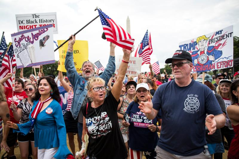 Demonstrators wave national flags and placards during the pro-Trump 'Mother of All Rallies' on the National Mall in Washington, DC on September 16, 2017.  (ZACH GIBSON/Getty Images)