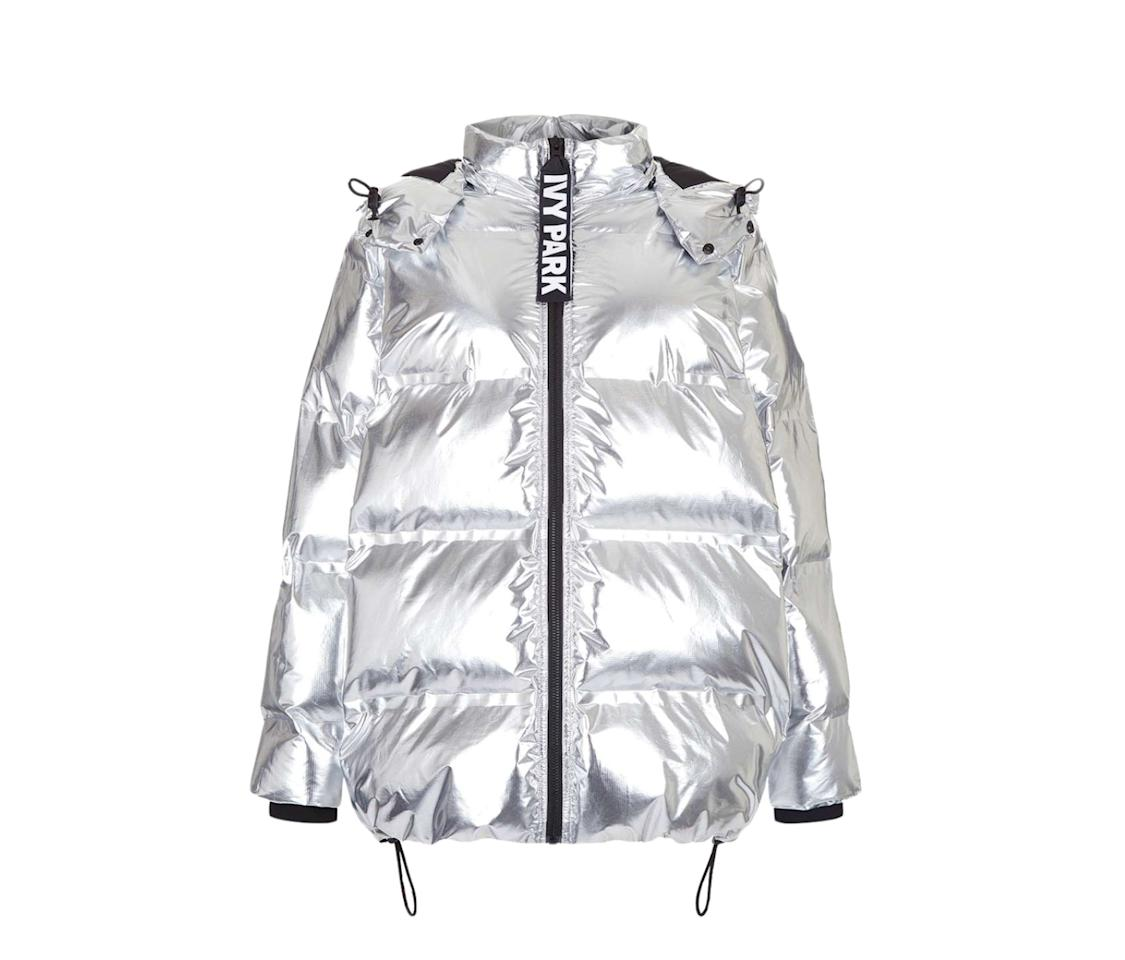 """<p>Customizable drawstrings and a reflective silver finish keep this Beyonce-approved puffer from feeling too retro. Wear this statement coat with your favorite sneakers or dress it up for an unexpected twist. <br /><br />$200, <a rel=""""nofollow"""" href=""""https://us.topshop.com/en/tsus/product/oversized-bonded-puffer-5859154?bi=0&ps=20&Ntt=puffer%20coat"""">topshop.com</a> </p>"""