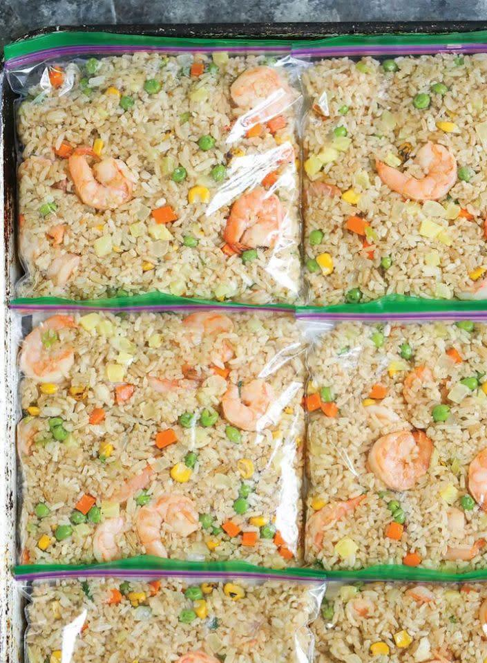 "<strong>Get the <a href=""https://damndelicious.net/2017/08/29/freezer-shrimp-fried-rice/"" rel=""nofollow noopener"" target=""_blank"" data-ylk=""slk:Freezer Shrimp Fried Rice recipe"" class=""link rapid-noclick-resp"">Freezer Shrimp Fried Rice recipe</a> from Damn Delicious</strong>"