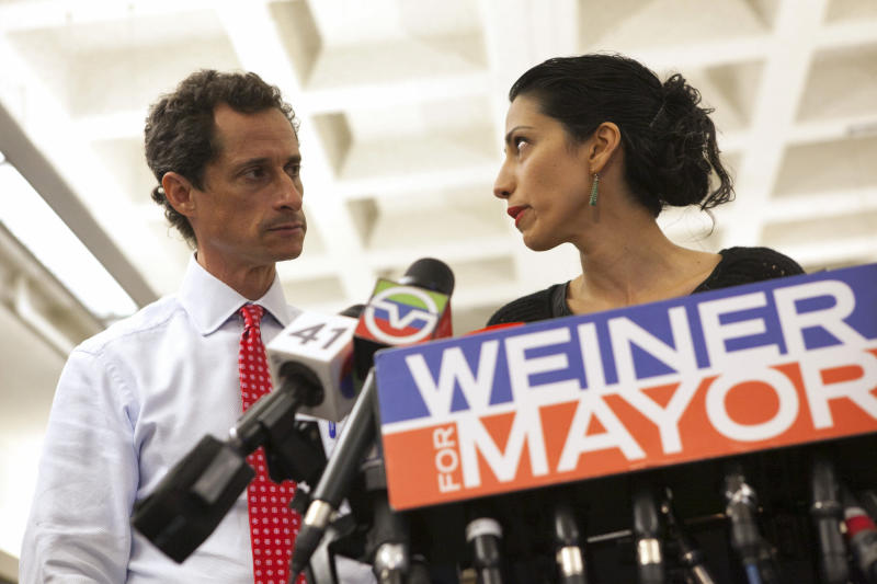 Anthony Weiner was joined by his wife, longtime Hillary Clinton aide Huma Abedin, at a news conference during his failed New York mayoral campaign in 2013. (ERIC THAYER / Reuters)