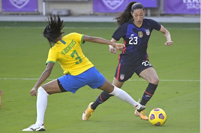United States forward Christen Press (23) controls a ball in front of Brazil defender Bruna (3) during the second half of a SheBelieves Cup women's soccer match, Sunday, Feb. 21, 2021, in Orlando, Fla. (AP Photo/Phelan M. Ebenhack)