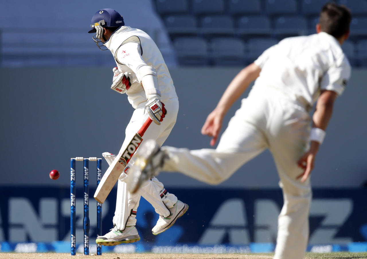 India's Zaheer Khan misses the ball from New Zealand's Tim Southee (R) during his second innings on day four of the first international test cricket match at Eden Park in Auckland, February 9, 2014. REUTERS/Nigel Marple (NEW ZEALAND - Tags: SPORT CRICKET)