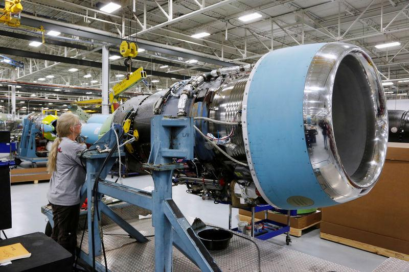 FILE PHOTO: Cessna employee Lee York works on an engine of a Cessna business jet at the assembly line at their manufacturing plant in Wichita