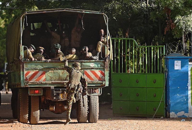A member of Kenya Defence Forces boards a truck in Garissa on April 3, 2014