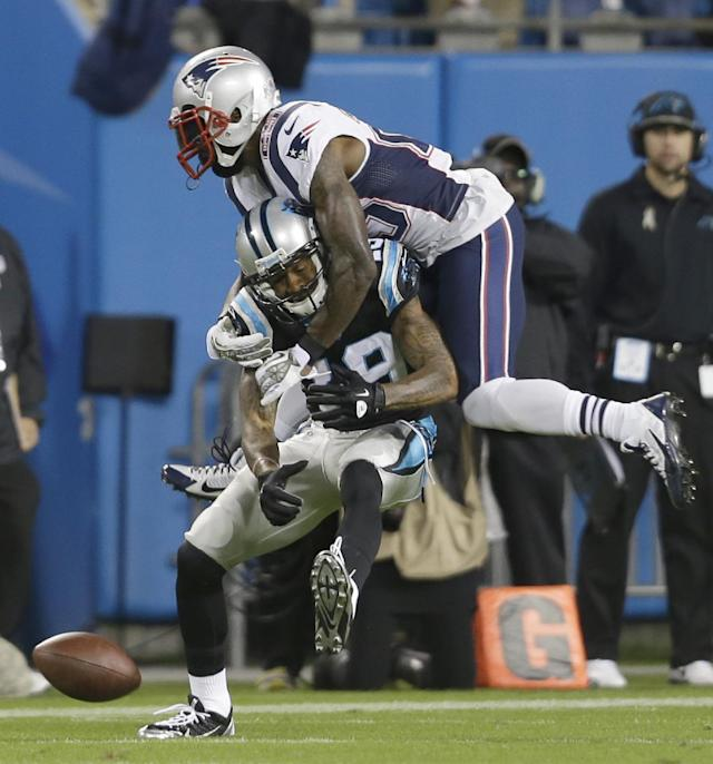 New England Patriots' Kyle Arrington, top, knocks the ball from Carolina Panthers' Ted Ginn, bottom, during the first half of an NFL football game in Charlotte, N.C., Monday, Nov. 18, 2013. (AP Photo/Gerry Broome)