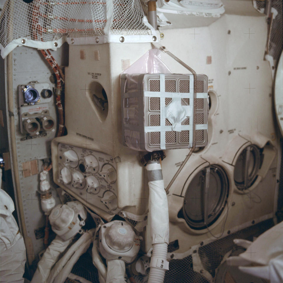 "This April 1970 photo made available by NASA shows the interior of the Apollo 13 lunar module with the ""mail box,"" an ad hoc device which the crew assembled while in space to remove carbon dioxide from the air. It was designed and tested on the ground in Houston. Because of the explosion of one of the oxygen tanks in the service module, the three men had to use the lunar module as a ""lifeboat"" on their way back to Earth. (NASA via AP)"