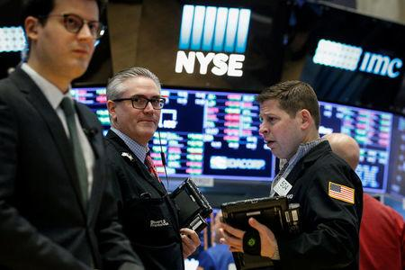FILE PHOTO: Traders work on the floor of the New York Stock Exchange, (NYSE) in New York, U.S., February 26, 2018. REUTERS/Brendan McDermid