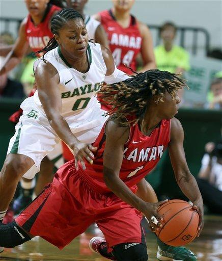 Lamar's Gia Ayers, right, grabs a loose ball in front of Baylor's Odyssey Sims, left, during the first half of an NCAA college basketball game, Friday, Nov. 9, 2012, in Waco, Texas. Baylor won 80-34. (AP Photo/Waco Tribune Herald, Rod Aydelotte)