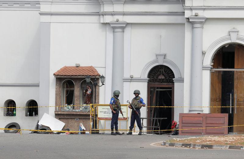 Security personnel stand guard outside St. Anthony Shrine in Colombo