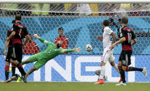 United States' goalkeeper Tim Howard can not stop a shot by Germany's Thomas Mueller to score his side's first goal during the group G World Cup soccer match between the United States and Germany at the Arena Pernambuco in Recife, Brazil, Thursday, June 26, 2014. (AP Photo/Julio Cortez)
