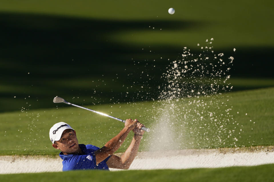 Collin Morikawa hits out of a bunker on the ninth hole during the second round of the Masters golf tournament Friday, Nov. 13, 2020, in Augusta, Ga. (AP Photo/Chris Carlson)