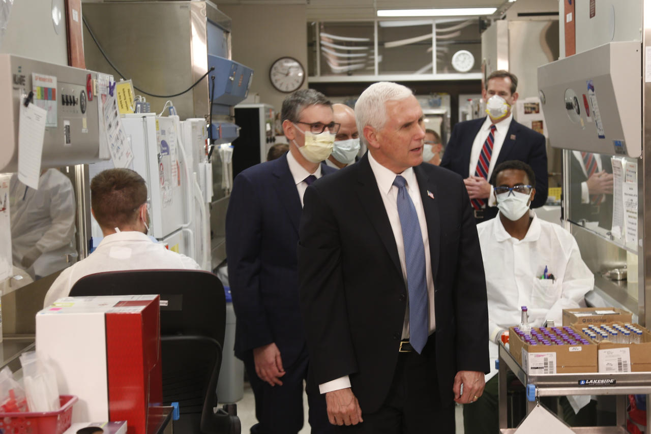Vice President Mike Pence visits the molecular testing lab at Mayo Clinic Tuesday, April 28, 2020, in Rochester, Minn., where he toured the facilities supporting COVID-19 research and treatment. (AP Photo/Jim Mone)