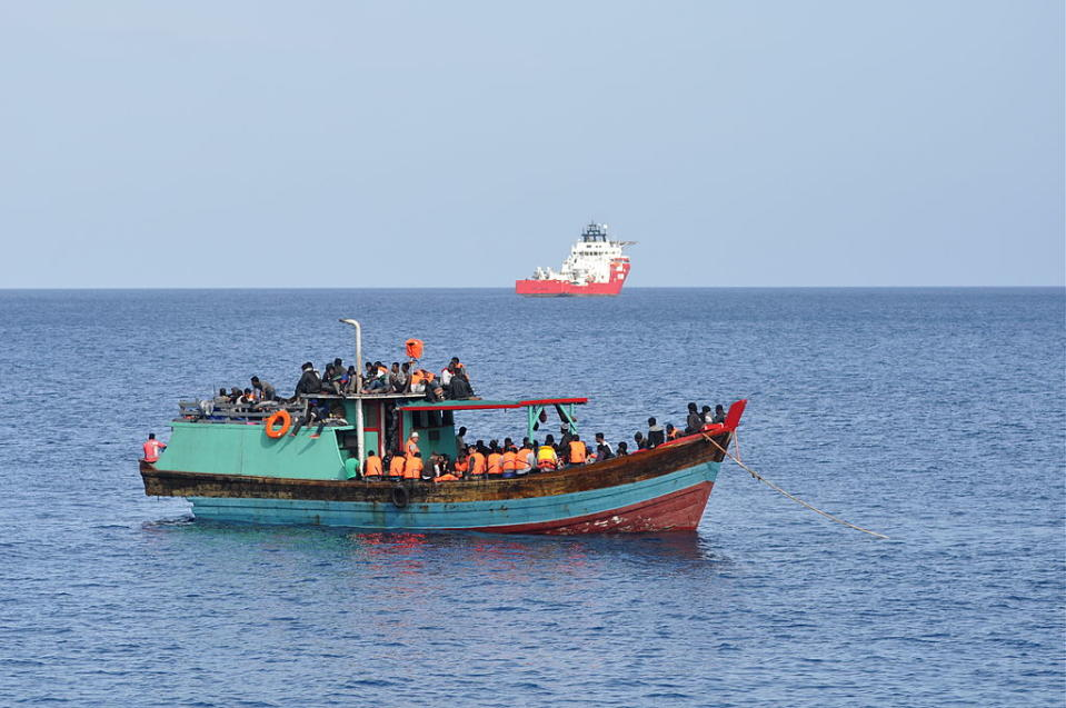 CHRISTMAS ISLAND - OCTOBER 13: Suspected asylum seekers arrive at Christmas Island, after receiving assistance by Australian Navy, on October 13, 2012 on Christmas Island. Reports suggest that a vessel was spotted by an RAAF maritime patrol plane, and HMAS Bundaberg and HMAS Wollongong assisted with the transfer. (Photo by Scott Fisher/Getty Images)