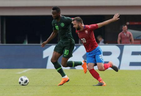 Soccer Football - International Friendly - Czech Republic vs Nigeria - Rudolf-Tonn-Stadion, Schwechat, Austria - June 6, 2018 Nigeria's John Obi Mikel in action with Czech Republic's Josef Husbauer REUTERS/Heinz-Peter Bader