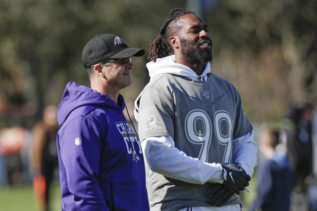 FILE - In this Jan. 22, 2020, file photo, AFC head coach John Harbaugh, left, of the Baltimore Ravens, talks with Ravens linebacker Matthew Judon during a practice for NFL Pro Bowl football game, in Kissimmee, Fla. The Ravens have placed the franchise tag on outside linebacker Matthew Judon, a sack specialist who was sure to garner plenty of attention from around the league next week as an unrestricted free agent. By designating Judon as the 2020 franchise player, the Ravens have additional time to work out a long-term deal with their fifth-round pick in the 2016 draft after the start of free agency on Monday, March 16, 2020. (AP Photo/John Raoux, File)
