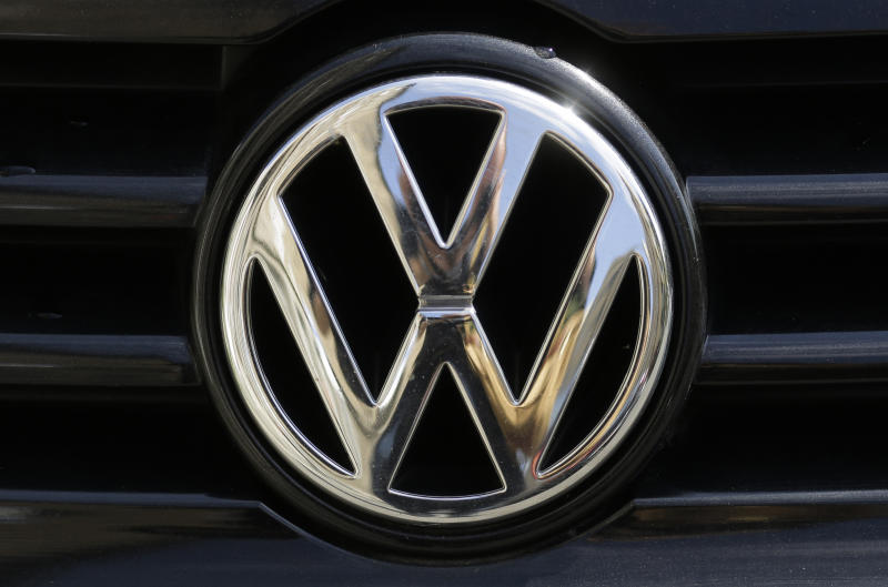 FILE - In this Aug. 1, 2017 file photo the car marques badge of Volkswagen, VW, is photographed on a car in Berlin, Germany.  Economists at the Halle Institute for Economic Research issued a report Monday Feb. 11, 2019, saying a no-deal Brexit would affect more than 100,000 jobs in Germany that depend on trade with Britain, with the auto industry hardest hit. (AP Photo/Markus Schreiber, file)