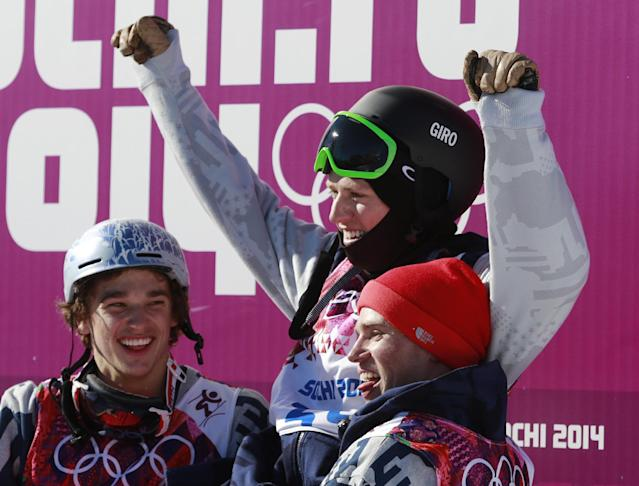 Gold medal winner Joss Christensen of the United States, top, is carried by compatriots Nicholas Goepper, left, who won bronze, and Gus Kenworthy, who won silver, after the men's ski slopestyle final at the Rosa Khutor Extreme Park, at the 2014 Winter Olympics, Thursday, Feb. 13, 2014, in Krasnaya Polyana, Russia. (AP Photo/Gero Breloer)