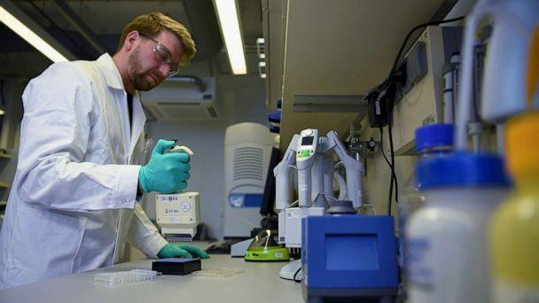 FILE PHOTO: Employee Philipp Hoffmann, of German biopharmaceutical company CureVac, demonstrates research workflow on a vaccine for the coronavirus (COVID-19) disease at a laboratory in Tuebingen, Germany, March 12, 2020. (Andreas Gebert/Reuters)