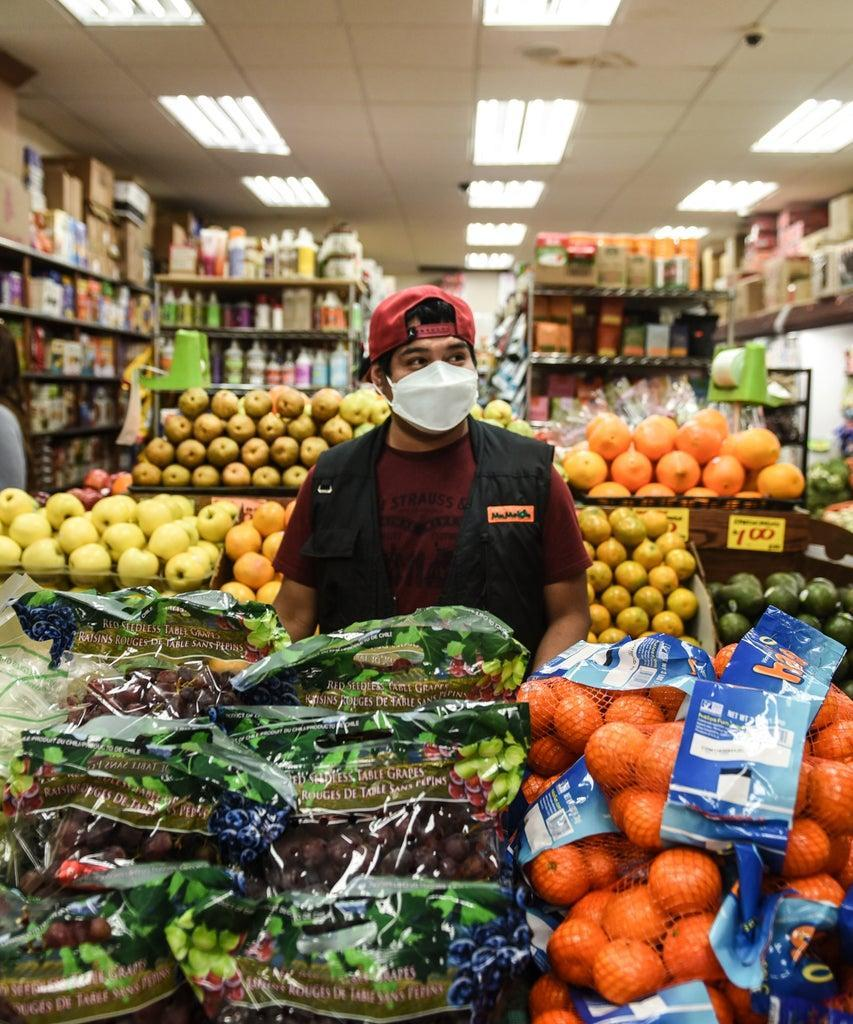 NEW YORK, NY – APRIL 28 : A bodega worker restocks produce on April 28, 2020 in the Brooklyn borough in New York City. Workers at bodegas are considered essential where in some areas 80 percent of the food is purchased, according to a report put out by New York City. (Photo by Stephanie Keith/Getty Images)