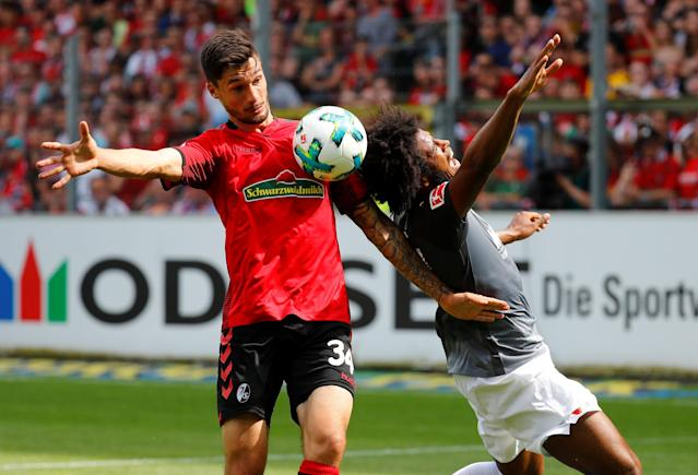 Soccer Football - Bundesliga - SC Freiburg v FC Augsburg - Schwarzwald-Stadion, Freiburg, Germany - May 12, 2018 SC Freiburg's Tim Kleindienst in action with Augsburg's Caiuby REUTERS/Kai Pfaffenbach DFL RULES TO LIMIT THE ONLINE USAGE DURING MATCH TIME TO 15 PICTURES PER GAME. IMAGE SEQUENCES TO SIMULATE VIDEO IS NOT ALLOWED AT ANY TIME. FOR FURTHER QUERIES PLEASE CONTACT DFL DIRECTLY AT + 49 69 650050