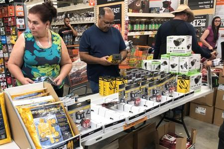 People shop for supplies at a Home Depot store ahead of the arrival of Hurricane Dorian in Miami