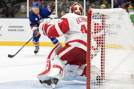 Detroit Red Wings goaltender Jonathan Bernier (45) tends the net against New York Islanders center Mathew Barzal (13) during the second period of an NHL hockey game, Saturday, Dec. 15, 2018, in Uniondale, N.Y. (AP Photo/Mary Altaffer)