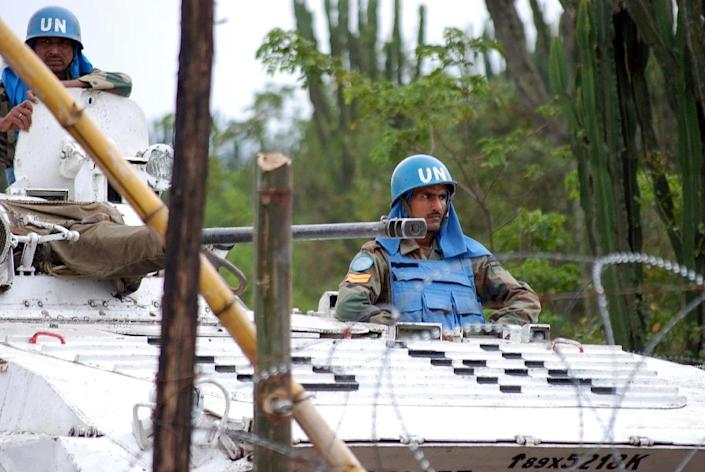 More than 125,000 troops and police from 124 countries serve in UN peace missions (AFP Photo/Alain Wandimoyi)