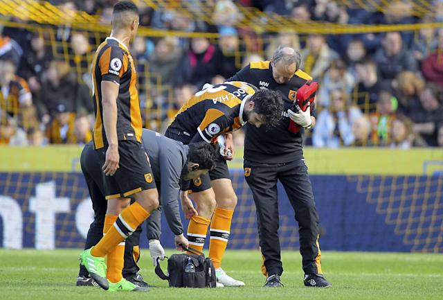 <p>Hull City's Andrea Ranocchia receives medical attention </p>