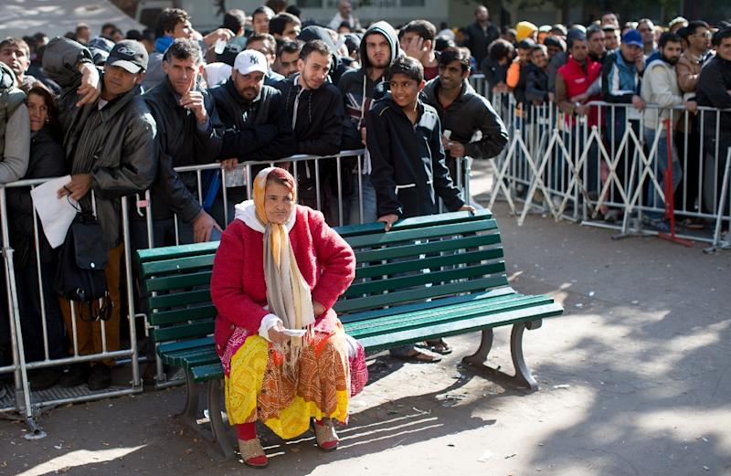Migrants wait to register in Berlin on October 1, 2015