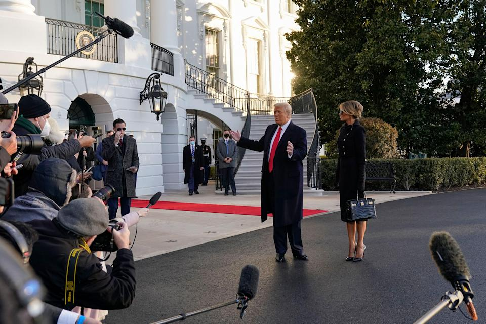 President Donald Trump and first lady Melania Trump stop to talk with the media as they walk to board Marine One on the South Lawn of the White House.
