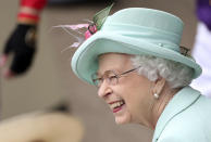 Britain's Queen Elizabeth II smiles, during day five of of the Royal Ascot horserace meeting, at Ascot Racecourse, in Ascot, England, Saturday June 19, 2021. (David Davies/PA via AP)