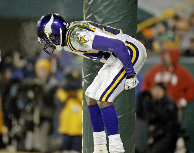 Minnesota Vikings receiver Randy Moss bends over to the crowd after catching a 34-yard touchdown pass on Jan. 9, 2005 against the Packers. (AP Photo/Morry Gash)