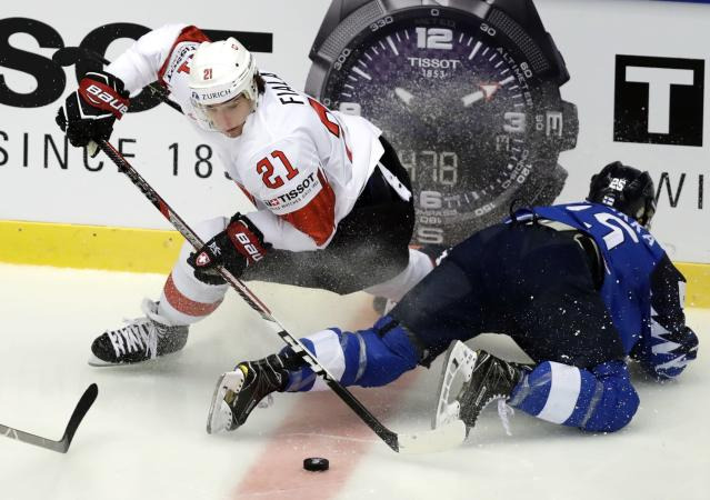 Ice Hockey - 2018 IIHF World Championships - Quarterfinals - Finland v Switzerland - Jyske Bank Boxen - Herning, Denmark - May 17, 2018 - Kevin Fiala of Switzerland in action with Pekka Jormakka of Finland. REUTERS/David W Cerny