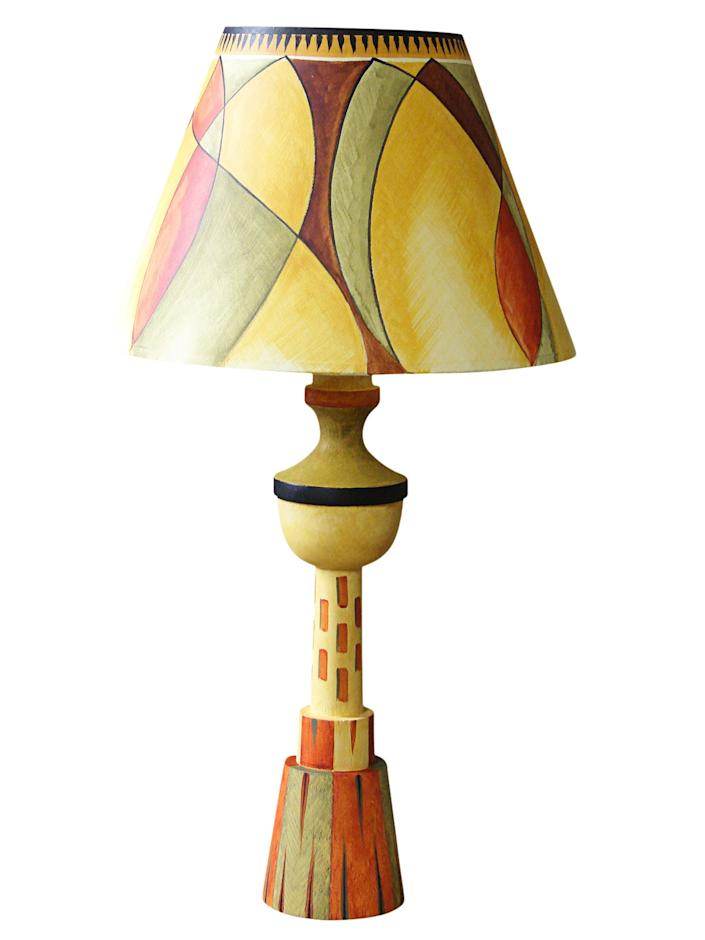 """<div class=""""caption""""> Omega lamp with yellow Kristian empire shade; $242. <a href=""""https://bloomsbury-interiors.co.uk/"""" rel=""""nofollow noopener"""" target=""""_blank"""" data-ylk=""""slk:bloomsbury-interiors.co.uk"""" class=""""link rapid-noclick-resp""""><em>bloomsbury-interiors.co.uk</em></a> </div> <cite class=""""credit"""">Photo: Courtesy of Bloomsbury Interiors</cite>"""