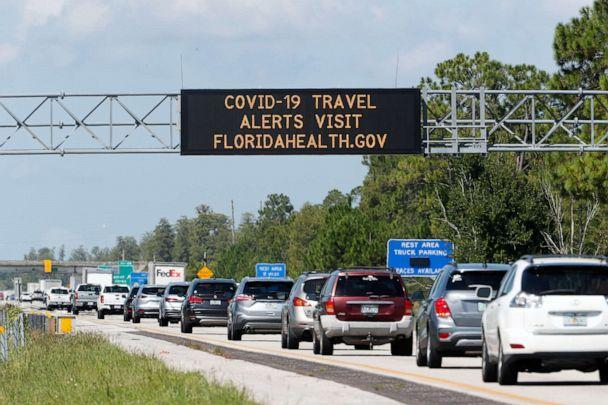 PHOTO: A COVID-19 sign alerting drivers to visit FLORIDAHEALTH.GOV during their commute on Interstate I-4 on Aug. 14, 2020 in Kissimmee, Fla. (Octavio Jones/Getty Images)
