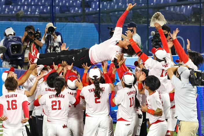 Players crowd surf a man.