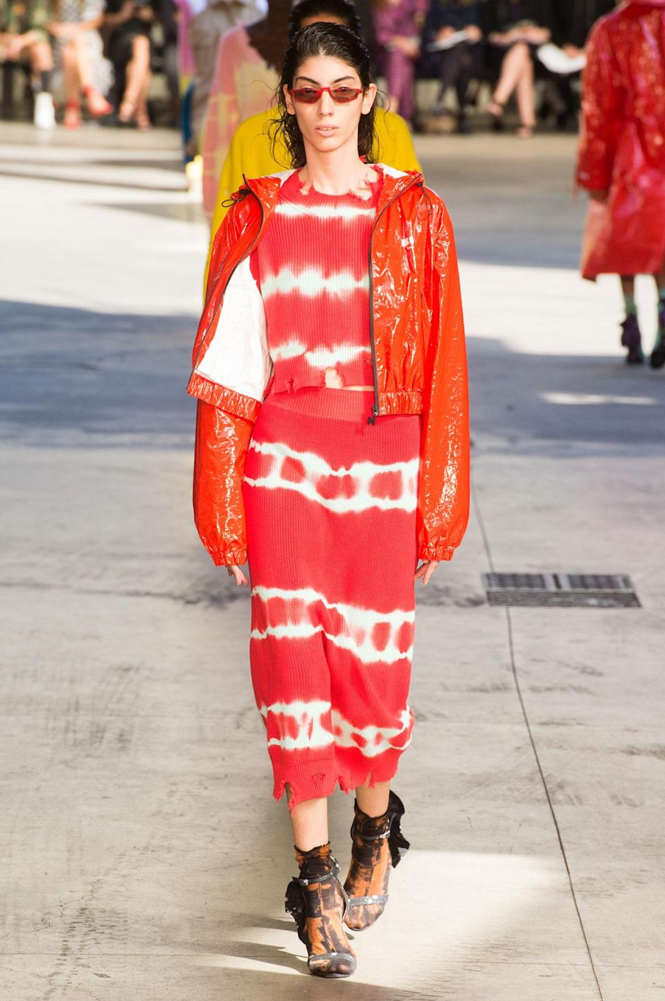 <p>Bright orange tie dye dress and patent leather jacket from the SS18 MSGM collection. (Photo: ImaxTree) </p>