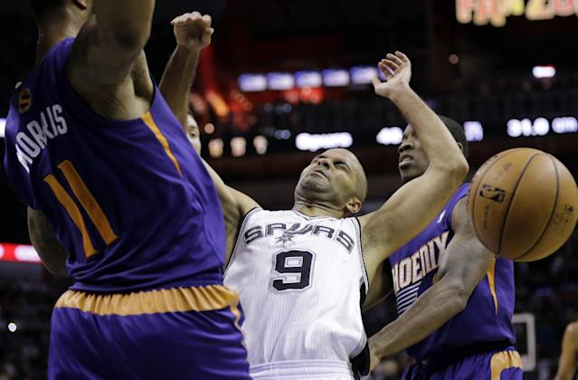 San Antonio Spurs' Tony Parker (9), of France, looses control of the ball as he is fouled by Phoenix Suns' Markieff Morris (11) during the first half of an NBA basketball game Wednesday, Nov. 6, 2013, in San Antonio. (AP Photo/Eric Gay)